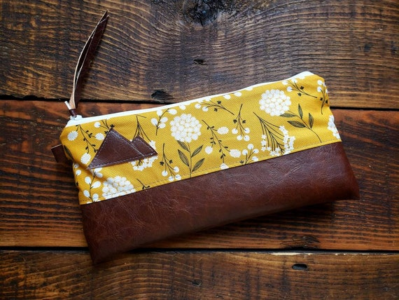 Wally clutch/Yellow pom flower print/White zipper/Vegan leather details/Gray canvas back/Choose Montana or Mountain patch/ Montana bags