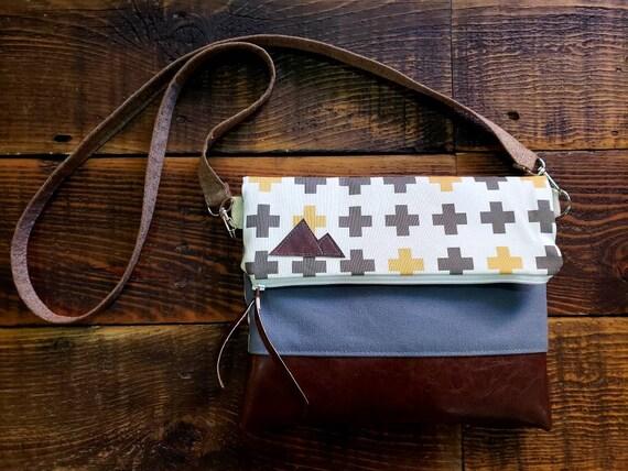 Fildover crossbody/Gold & Taupe swiss cross on white/Dark vegan leather/White zipper/Gray canvas reverse/Brown linen strap