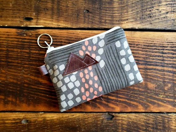 Coin pouch/credit card pouch/Flathead lake grays & peach print front and back/Natural canvas liner/White zipper/Montana or Mountain patch