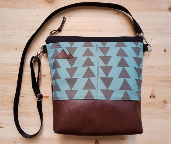 Large crossbody/Teal & charcoal triangles print=2 front pockets/Black canvas back/Black zipper/Black adjustable nylon strap/MT or Mountain