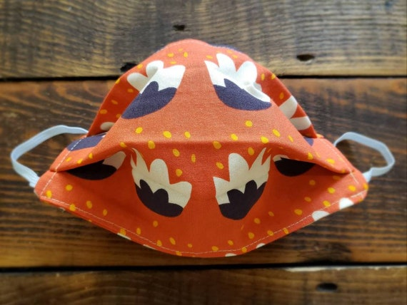 Orange bloom print/Basic fabric mask + elastic ear straps/NO returns, refunds, alterations or exchanges/Read description before purchasing