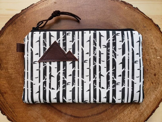 Birch print pouch/3 size options/printed front and back/Natural canvas liner/Black zipper/Mountain or Montana patch/Vegan leather details