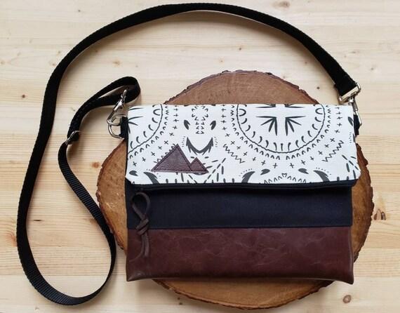 Foldover crossbody/Ivory & black bohemian print/Black zipper/Black canvas reverse/Black nylon adjustable strap/Mountain or Montana patch