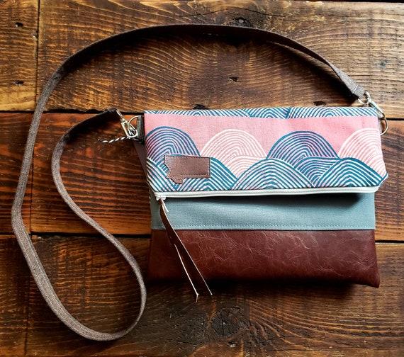 Foldover crossbody/Sunset print/Dark vegan leather/White zipper/Gray canvas reverse/Brown linen strap