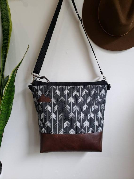 Large crossbody/True North print in black with white arrows=2 front pockets/Black canvas/Black zipper/Black adjustable nylon strap
