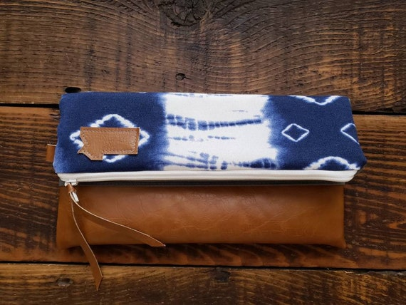 Foldover clutch/Navy & white shibori print front and back/Mountain or Montana patch/Vegan leather details/White zipper
