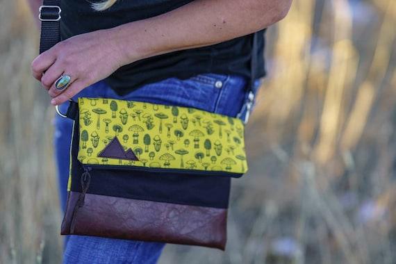 Foldover crossbody/Yellow mushroom print/Black zipper/Black canvas reverse/Black nylon adjustable strap/Mountain or Montana patch