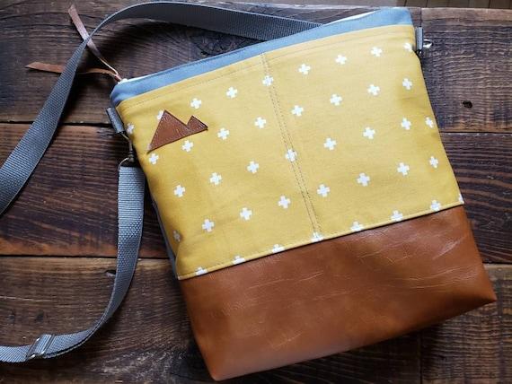 Large crossbody/Yellow & white swiss cross print/2 front pockets/Vegan leather/Gray canvas back/White zipper/Adjustable gray nylon strap