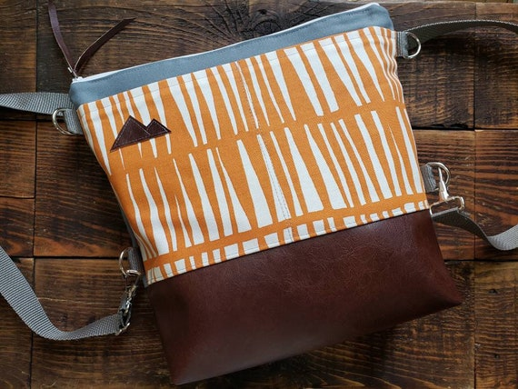 Convertible Backpack+Crossbody/Orange & white zag print=2 front pockets/Vegan leather/Gray canvas shell/White zipper/Montana or Mountain