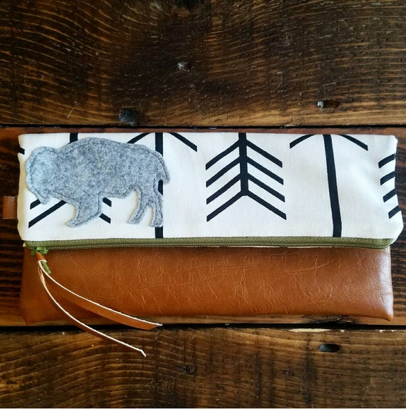 Bison foldover Clutch/White with black arrows print/Gray canvas reverse/Caramel vegan leather/Gray wool felt bison/Green zipper/Made in MT