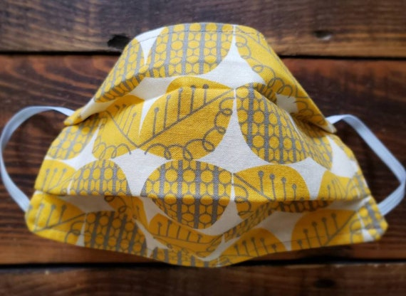 Yellow leaves/Basic fabric mask + elastic ear straps/NO returns, refunds, alterations or exchanges/Read description before purchasing