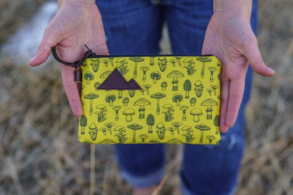 Available in 3 sizes/Yellow mushroom print front and back/Black zipper/Brown suede zipper pull/Montana or mountain patch