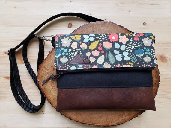 Foldover crossbody/Bold floral print/Black zipper/Black canvas reverse/Black nylon adjustable strap/Mountain or Montana patch