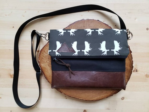 Foldover crossbody/Charcoal moose antlers print/Black zipper/Black canvas reverse/Black nylon adjustable strap/Mountain or Montana patch