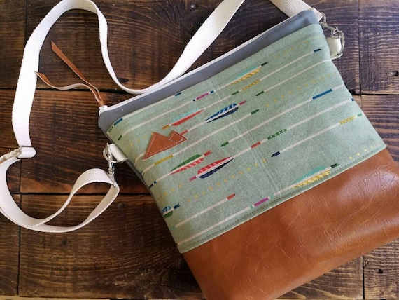 Large Crossbody/Green with arrows print/2 front pockets/Caramel brown vegan leather/Gray canvas/White zipper/Adjustable strap/MTN patch