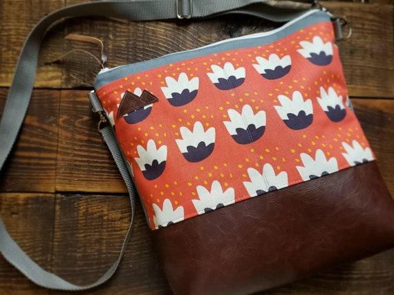 Large Crossbody/Orange floral print/2 front pockets/Dark brown vegan leather/Gray canvas/White zipper/Adjustable strap/MTN patch