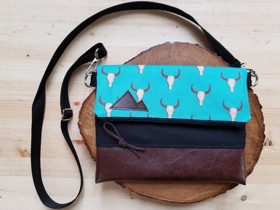Foldover crossbody/Teal desert print/Black zipper/Black canvas reverse/Black nylon adjustable strap/Mountain or Montana patch
