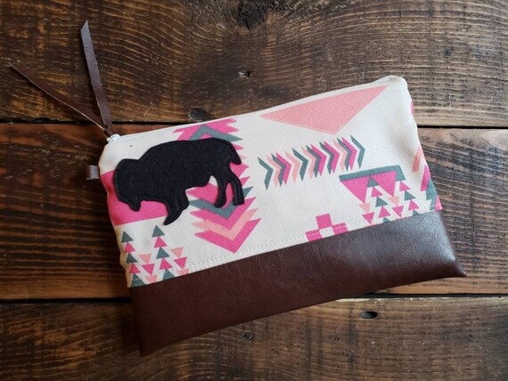 Grab & Go Clutch/Western in pinks and grays print front and back/White zipper/Vegan leather details/Wool bison patch 4 color options