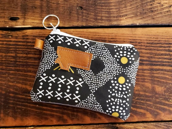 Coin pouch/credit card pouch/Black, white and olive mud cloth print front & back/Natural canvas liner/White zipper/Mountain or Montana patch