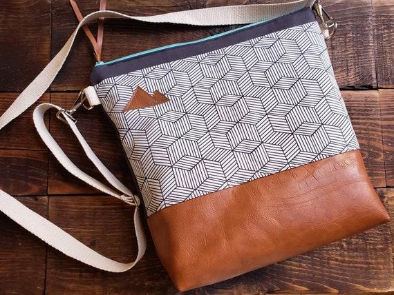 Large crossbody/White & Black geo print=2 front pockets/Vegan leather details/Graphite gray bull denim back/Teal zipper/MT or Mountain patch