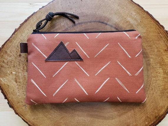 Chevron in rust & white pouch/3 size options/printed front and back/Natural canvas liner/Black zipper/Mountain or Montana patch