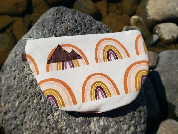 Half moon clutch/phone pouch/Rainbow print front and back/Natural canvas liner/White zipper/Montana or Mountain patch/Vegan leather