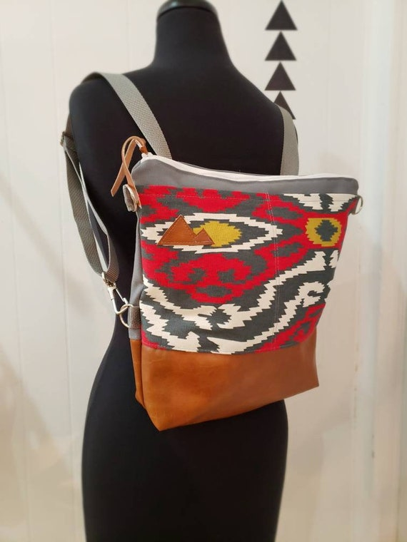 Convertible crossbody backpack/Multicolor SW print=2 front pockets/Vegan leather/Gray canvas shell/White zipper/Montana or Mountain patch
