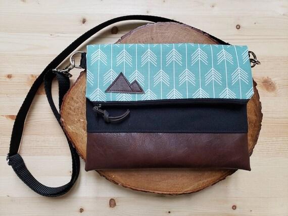 Foldover crossbody/Feathered arrows teal print/Black zipper/Black canvas reverse/Black nylon adjustable strap/Mountain or Montana patch