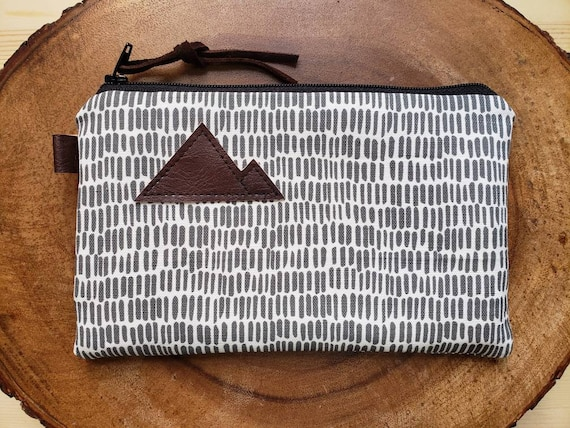 Gray & white dashing print/3 size options/printed front and back/Natural canvas liner/Black zipper/Mountain or Montana patch/Vegan leather