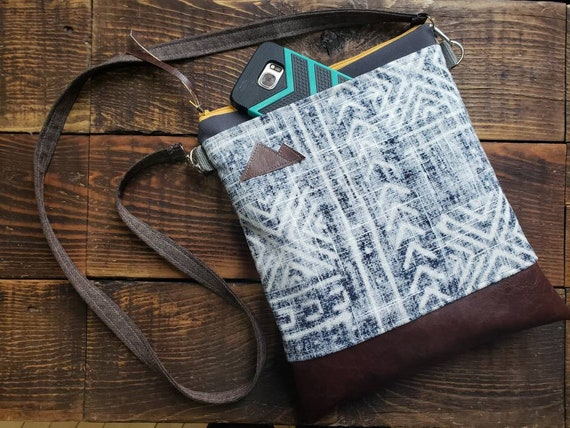 Pocket crossbody/Muted mud cloth print/Dark vegan leather/Yellow zipper/Gray canvas reverse/Brown linen strap