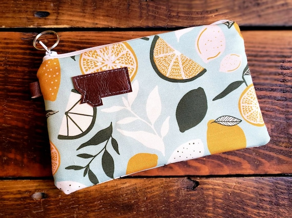 Phone pouch/credit card pouch/Lemon drop print front and back/Natural canvas liner/White/Montana or Mountain patch/Vegan leather details
