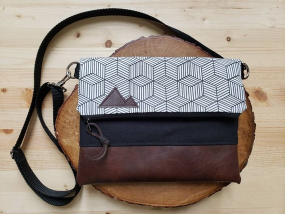 Foldover crossbody/Geo White & black print/Black zipper/Black canvas reverse/Black nylon adjustable strap/Mountain or Montana patch