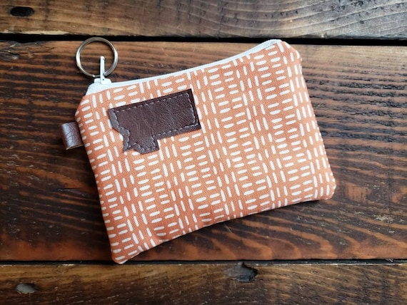 Coin pouch/credit card pouch/Orange & white fall print front and back/Natural canvas liner/White zipper/MT or Mountain patch/Vegan leather