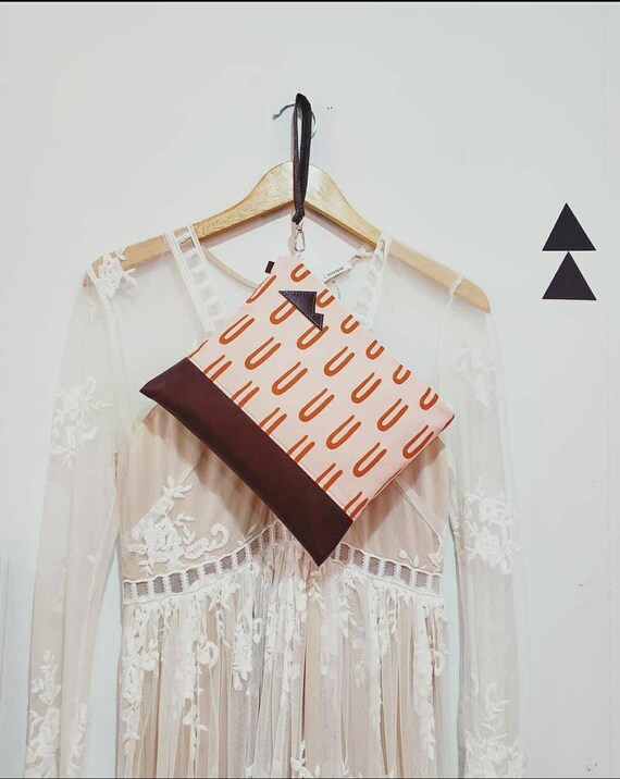 Wristlet clutch/Peachy pink and rust U print front and back/Vegan leather/Mountain or Montana patch/White zipper/Made to order