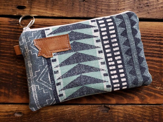 Phone pouch/Westward print front and back/Heavyweight natural canvas liner/White zipper/Montana or Mountain patch/Key ring zipper pull