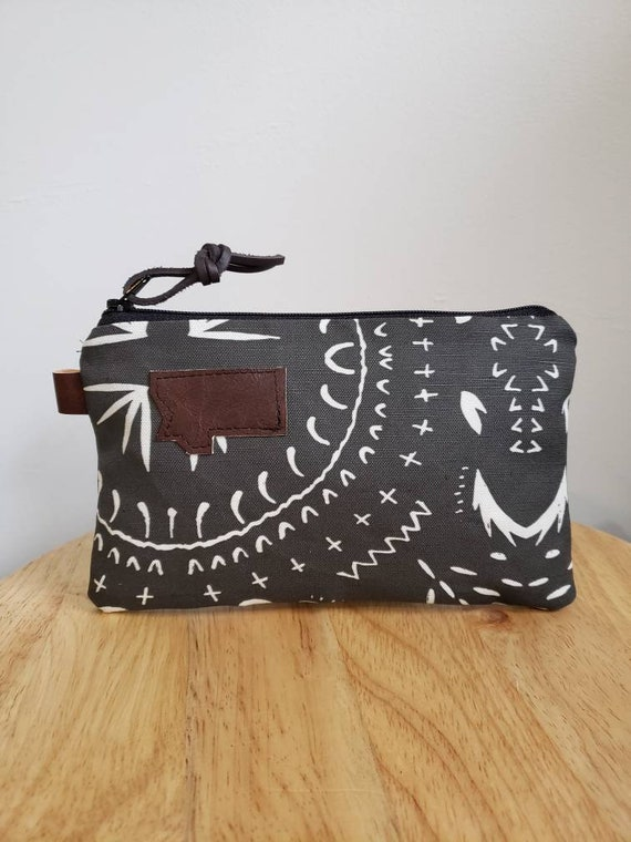 3 size options/Bohemian print in charcoal = front and back/Natural canvas liner/Black zipper/Mountain or Montana patch