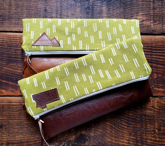 One Foldover Clutch-Lime with white dashes linen print/Gray canvas reverse/Vegan leather details/White zipper/Montana or mountain