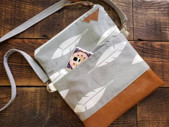 Add an outside slip pocket to the purchase of your foldover crossbody. Can be added to the front or back or both!