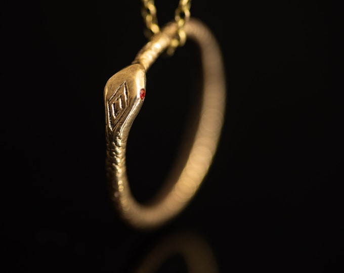 Ouroboros snake pendant - bronze with emerald eyes