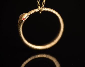 Ouroboros snake pendant - bronze with emerald eyes