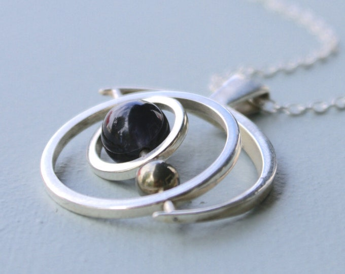 the Saturn Gryoscope necklace - Iolite and pyrite