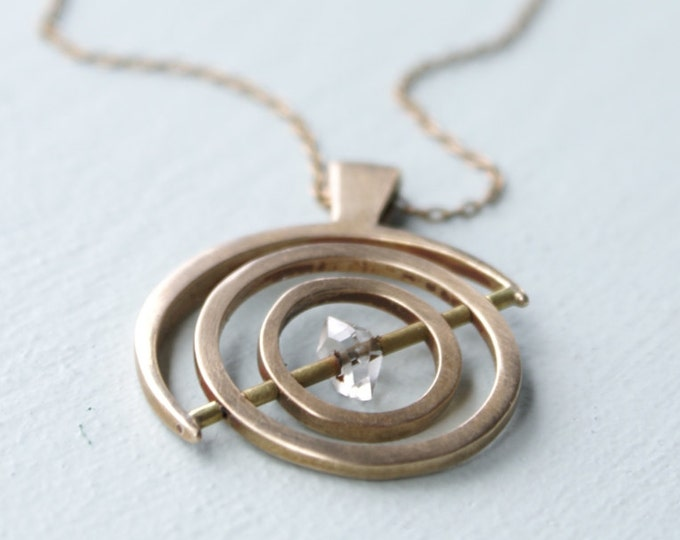 Gyroscope pendant - bronze with Herkimer Diamond, 1 axis
