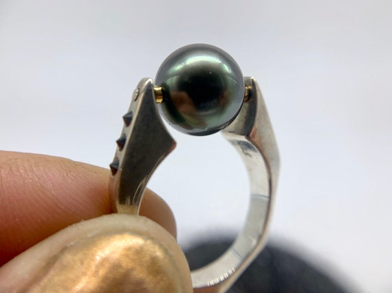 Black pearl rolling ring with black diamonds and 14k gold accents, size 8, sterling silver