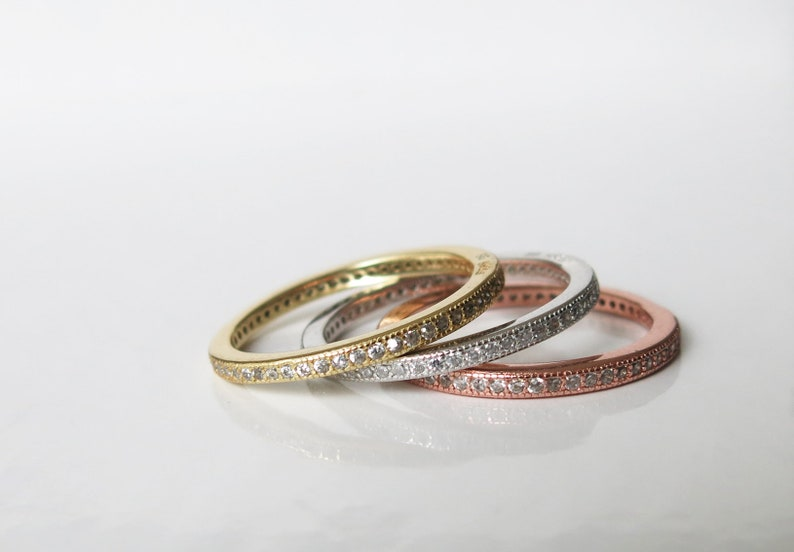 stacking rings with channel set clear cubic zirconia crystals Set of tri-colour sterling silver, rose gold and 14K gold vermeil size 8