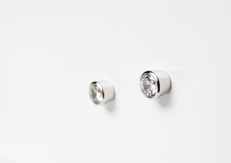 Sterling silver and cubic zirconia stud earrings with butterfly backs