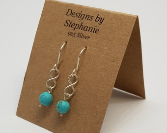 Turquoise Howlite Gemstone Infinity Drop Earrings. 925 Sterling Silver, Boho Drop Earrings. Designs by Stephanie