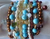 Multi strand turquoise, pearl,semi preciouse stones and sterling silver bracelet.Aquamarine, garnets,citrine,fresh water pearls.