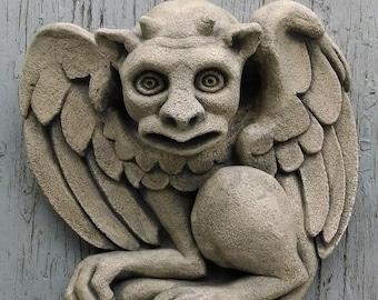 The Hypnotist gargoyle, wall art sculpture, Chicago Gothic, Halloween horror, carved stone casting, architectural detail, Richard Chalifour