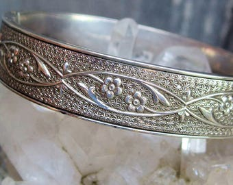 "Sterling Silver Hinged Bangle Bracelet, Embossed Forget Me Not Flowers, Vines, Tongue and Groove Clasp, Signed, 6 3/4"" by 1/2"", Beautiful"