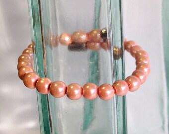 Magnetic hematite bracelet - pearly peach 6mm beads - custom sized